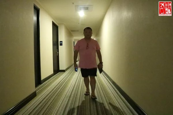 walking the hallway of Le Charme Suites