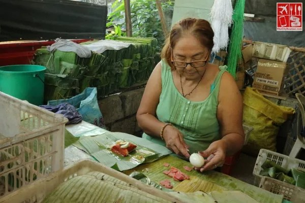 A lady making Tamales