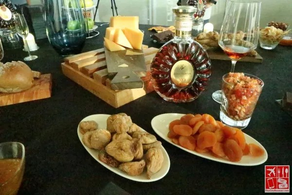 A spread of fruits, nuts, chocolates, and spices enjoyed with Remy Martin XO