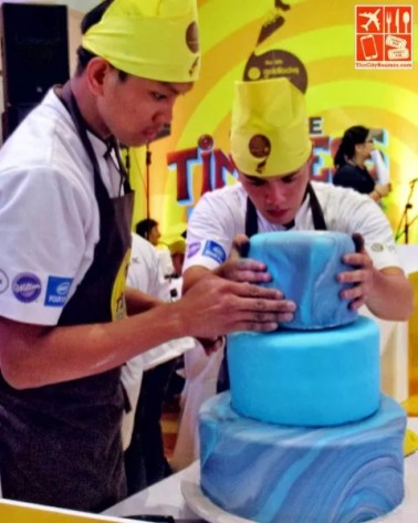 Decorating cakes with less than an hour left in the competition