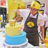 One of the finalists working to create a Philippine Cake of the Future for the final challenge