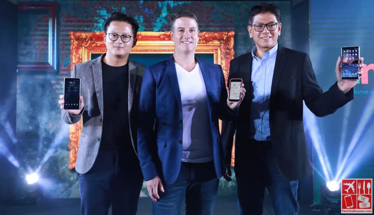 HMD Global executives showing off three of the four new Nokia phones launched