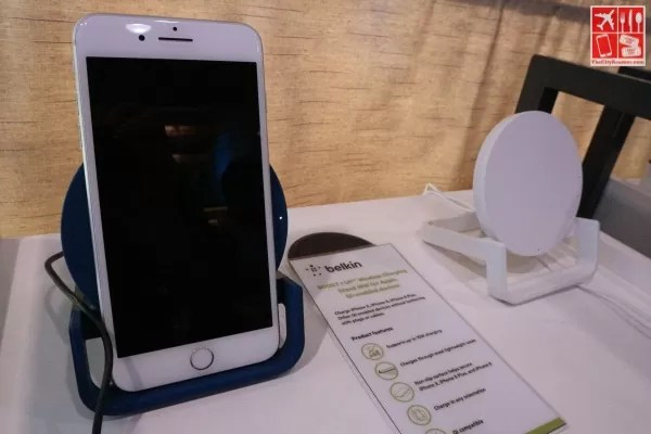 An iPhone cradled on a Belkin Wireless Charger