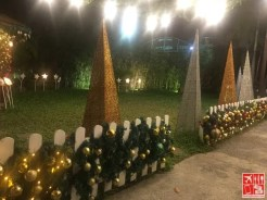 The surrounding area of Guevarra's decked with Christmas lights and decors