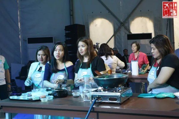 Bloggers getting cooking instructions from Chef JM Sunglao