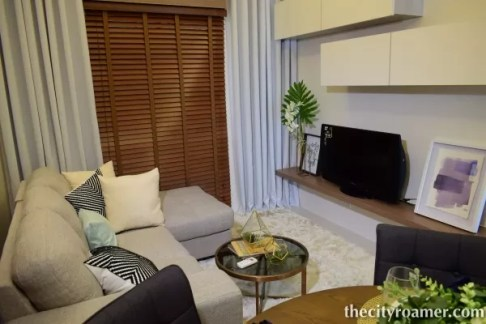 The Showroom - A setup of the living area with sofa and entertaiment wall