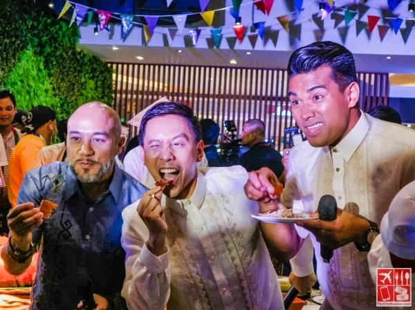Chef JP Anglo, Mikey Bustos, and Chef Jordan Andino enjoying Lechon, proving Eats. More Fun in the Philippines