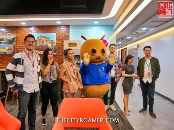 Teleperformance Philippines ambassadors with their mascot