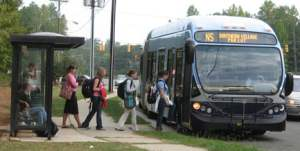 people boarding a public transportation bus