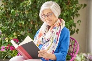 A resident enjoys a book.