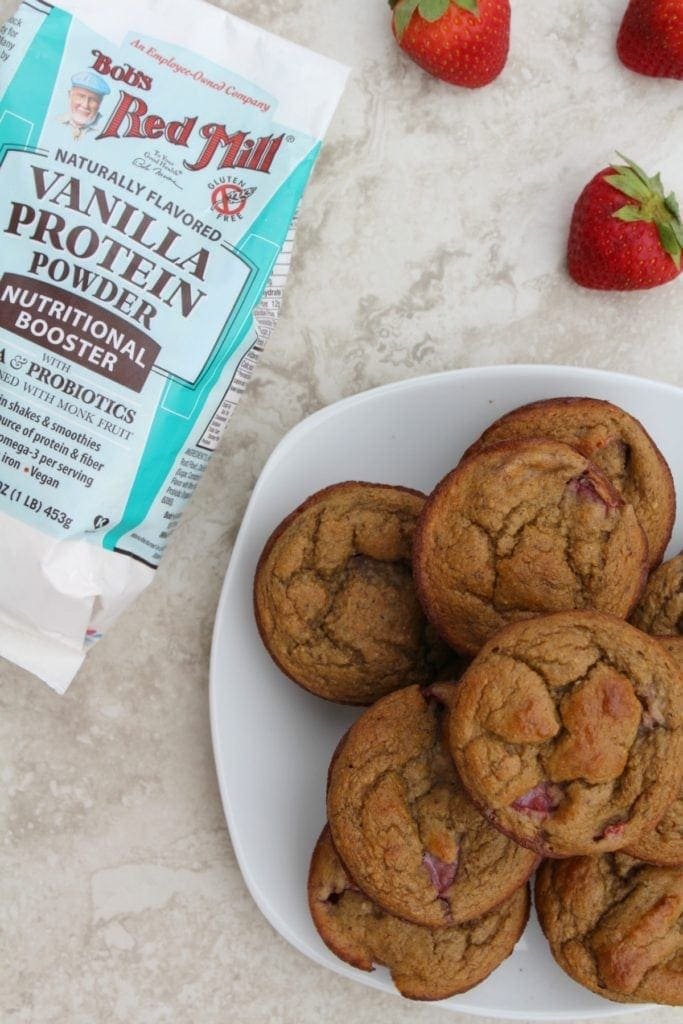 Strawberry Protein Muffins are gluten free and packed with protein and fresh berries. These muffins are the perfect simple healthy breakfast or snack.