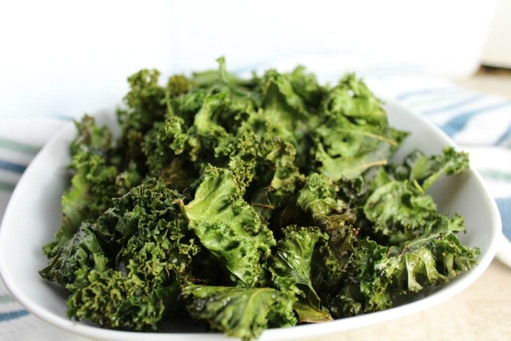 These Easy Kale Chips are a great vegan, gluten free and paleo friendly snack. They're so simple to make and have the perfect amount of crunch & saltiness!