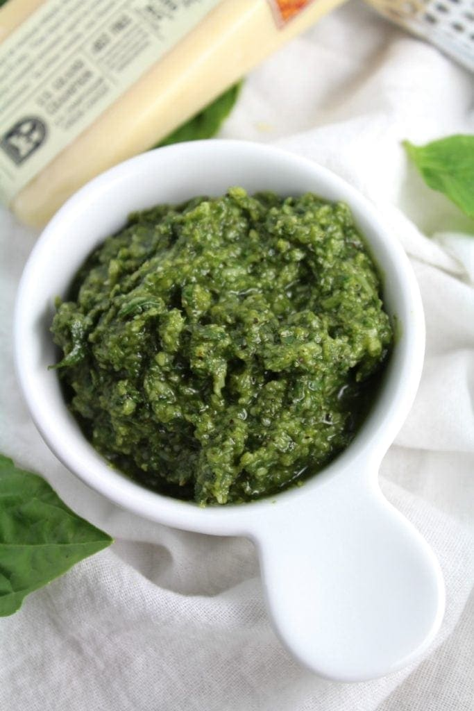 Searching for the perfect sauce, marinade, or dressing? This Healthy Four Ingredient Nut Free Pesto goes well with any meal + is so easy to make!