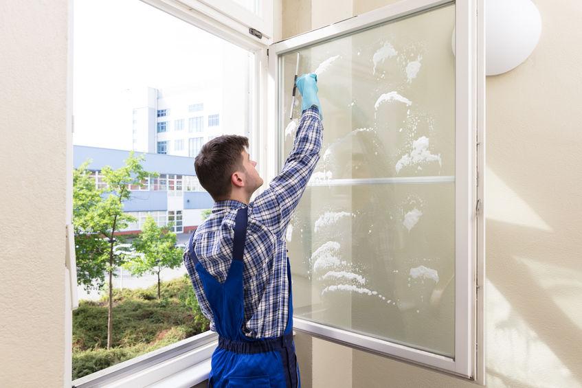 Housekeeper Cleaning Window