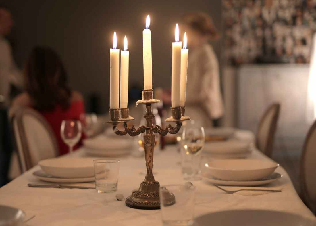gold candle holder with white candles
