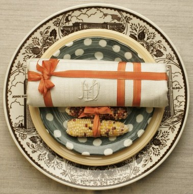 Rick E. Martin/Mercury News Styled by Vicki Thorne, napkin setting of a traditional Thanksgiving theme, with a vintage linen napking tied in a 1940's millenery ribbon with miniature indian corn.