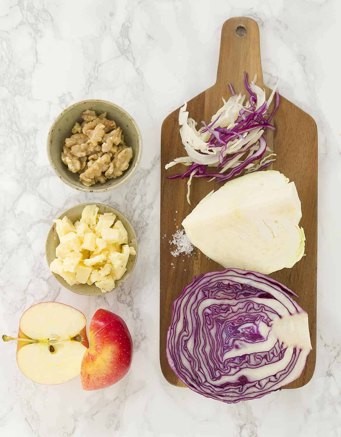 a few fresh and crunchy ingredients for this good and healthy cabbage and apple slaw.