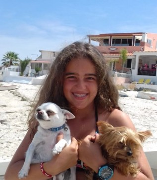 Photo of Beatriz Silva holding two dogs