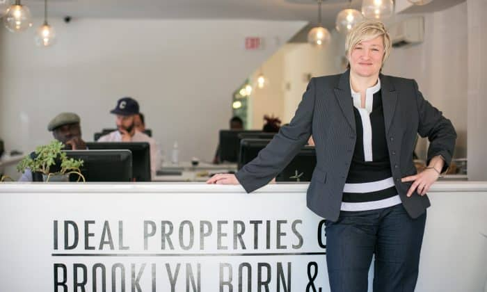 lady leaning on the table - How Custom Virtual Tours Can Save Your Real Estate Business in 2020