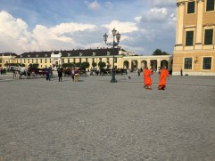 Visitors touring the front of the palace.