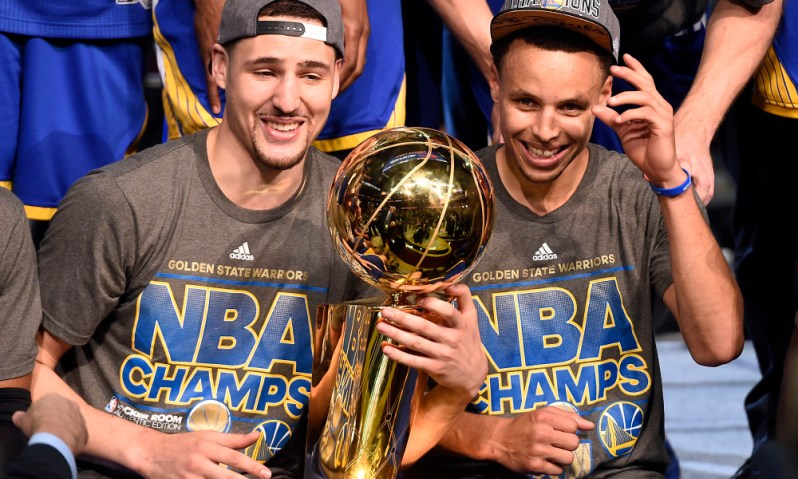 Jun 16, 2015; Cleveland, OH, USA; Golden State Warriors guard Klay Thompson (11) and guard Stephen Curry (30) celebrates with the Larry O'Brien Trophy after beating the Cleveland Cavaliers in game six of the NBA Finals at Quicken Loans Arena. Mandatory Credit: Bob Donnan-USA TODAY Sports ORG XMIT: USATSI-225722 ORIG FILE ID:  20150616_pjc_sd2_203.JPG