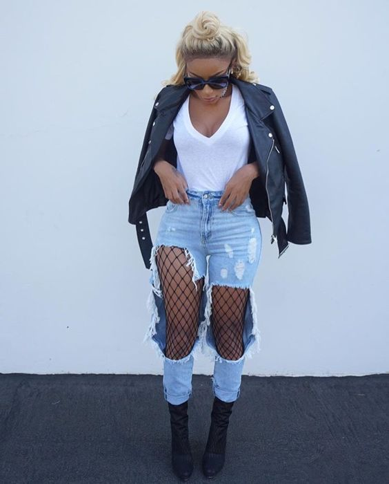 blonde wearing leather jacket fishnets and distressed jeans