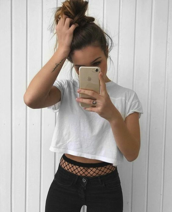 girl in cropped tee fishnets and black jeans