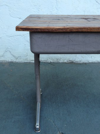 This 1950's era desk was found at a local parochial school as it was being modernized. We refurbished it and combined it with some reclaimed wood from a shipping pallet.
