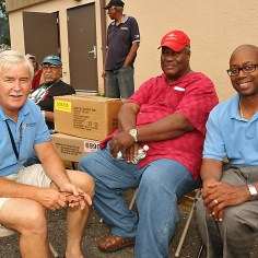 Neptune Mayor Eric Houghtaling (left) is pictured with Wesley Walker (center) and Neptune Township Committeeman Kevin McMillan at the cookout.