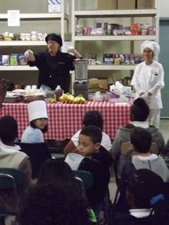 Tony Bratton, a chef in the Toms River school system, lectures students on the benefits of eating healthy while preparing a smoothie at the Foodbank of Monmouth and Ocean Counties in Neptune Oct. 16.