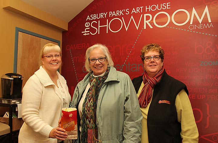 Ready for the movies at the Showroom in Asbury Park were (from left) Brett M. Drew and Lynne O'Neil, both of Ocean Grove with Debbie Boenig of the Showroom. - Coaster photo by Mike Kearns