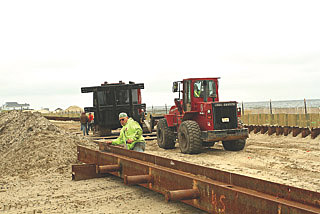 Coaster Photo - A contruction crew is scheduled to being driving pilings into the sand today (May 29) for a new boardwalk in Ocean Grove to replace the section destroyed by Hurricane Sandy.