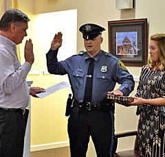 Bradley Beach Mayor Gary Englestad swears in new police officer, Andrew Redmond. COASTER photo.