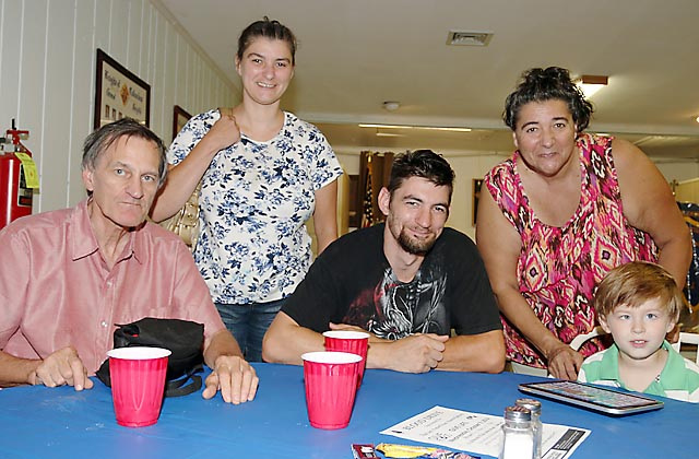 Enjoying refreshments at the Knights of Columbus dinner in Neptune City Sat., Sept. 13 were (standing) Jeannette and Jackie Dollive and seated Robert and Dan Dollive with Adan.