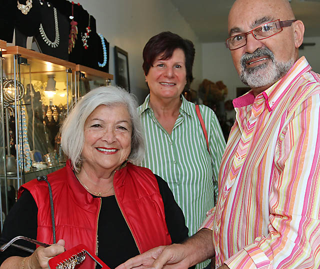Malcolm Navias of Heaven Antiques and Art in Asbury Park is pictured with Valerie Gross amd Arlene Geist, both of Jackson Township.