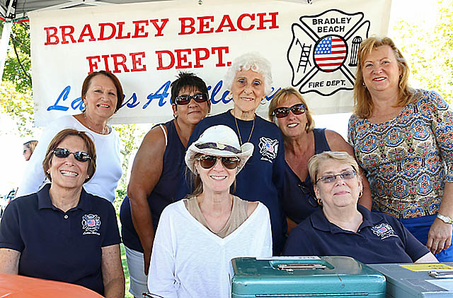 Helping out at the Bradley Beach Fire Department Ladies Auxiliary table at the festival Sat., Sept. 27 in Riley Park were (standing) Joan Wegrzyniak, Rose Crespo, Millie Domorski, Pam Cicerelli and Nanci Bachman. Seated were Judy Rubenstein, Beth Cotler and Kathie Christensen.