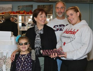 Pictured with some sweet treats at Criterion Candies in Convention Hall, Asbury Park were Oakhurst resident Adriana Foote and Diane Goldberg, Ron Boyadjian and Rayanna Raby of Criterion Candies.