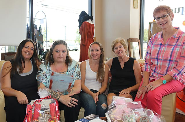 At the grand reopening of Second Chances gift shop in Neptune City were Theresa Ortenzio, Toms River; Marcel Delcorpo, business staff; Faith Petrowski, business staaff; Prudy White, Ocean Township and Jan Smith, Manasquan.