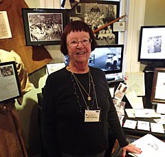 Coaster Photo - Former Oakhurst School student Mary Ann McKean, class of 1957, stands in front of a special exhibit at the Township of Ocean Historical Museum celebrating the school's 114-year history.