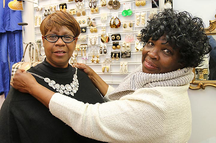 Geneva Smith, owner of Genava's all new boutique on Third Avenue in Neptune City, was helping Jackie Thomas of Neptune with some purchases.