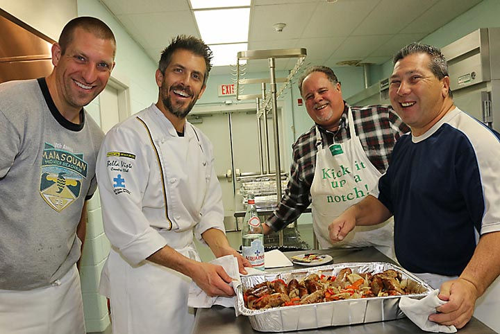 Serving free meals on Christmas Day at the Salvation Army in Asbury Park were Bryan Nevin, Spring Lake, Stephan Manno of Giamano's restaurant in Bradley Beach, Al Lingo of Avon and Sonny Church of Neptune.