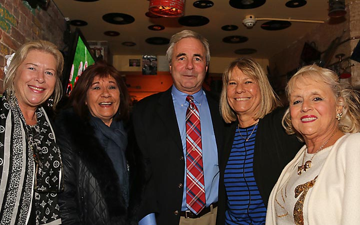 On New Year's Day after John Moor was sworn in as Asbury Park mayor family and friends gathered at a reception at Johnny Mac House of Spirits on Main Street. Pictured with his Moor is his wife, Vera (second from right), Sally Stevens (left), Kitty Madormo (second from left) and Rosemary Harris.