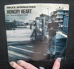 "Coaster Photos - Annmarie Solimini Adderley (below), who divides her time between Bradley Beach and North Bergen, is the girl on the bike on the sleeve cover of Bruce Springsteen's ""Hungry Heart"" single (pictured)."