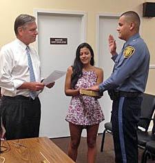 Coaster Photo - Bradley Beach Mayor Gary Engelstad swears in Edwin Hernandez as the newest member of the police department.