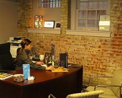 Coaster Photo - Jacqueline Pappas, executive director of the Asbury Park Chamber of Commerce, at her desk in the Chamber's new office space at the VFW building on Lake Avenue.