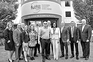Coaster Photo - Local and county officials gathered Tues., May 23 for the unveiling of the new name for the Foodbank of Monmouth and Ocean Counties in Neptune. It will now be called Fulfill.