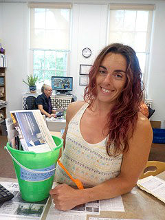 Rita Post, Bradley Beach library program coordinator, is pictured with the Welcome Pail available for newcomers of the borough. It can be picked up at the library circulation desk.