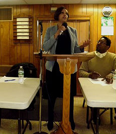 Coaster photo - Kristie M. Howard, director of student services in the Asbury Park school district, speaking at a breakfast at Second Baptist Church in Asbury Park.