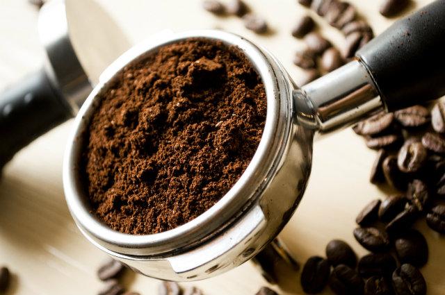 coffee grounds for espresso in portafilter