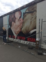 """""""The Kiss"""" depicts Soviet leader Leonid Brezhnev giving the East Germany President Erich Honecker which is based on an actual photograph taken in 1979 in honor of the thirtieth anniversary of the German Democratic Republic–East Germany. It's also probably one of the most iconic murals on the wall"""